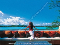 ile_des_deux_cocos_villa_mauritius_lady_on_balcony_and_sea_view.jpg
