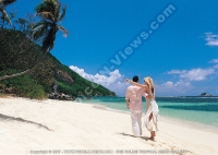 sainte_anne_resort_seychelles_couple_going_for_a_walk_on_the_ beach.jpg