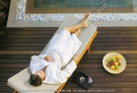 sainte_anne_resort_seychelles_guest_relaxing_in_sun_bed_at_the_spa.jpg